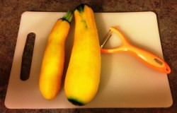 Two golden zucchinis from our garden and my julienne peeler